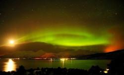 midnight sun with aurora borialis